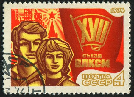 RUSSIA - CIRCA 1974: stamp printed by Russia, shows Young Man and Woman, circa 1974. photo