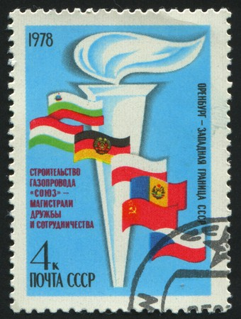 pyromania: RUSSIA - CIRCA 1978: stamp printed by Russia, shows torch and flag, circa 1978.