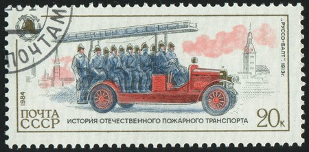 stamp printed by Russia, shows retro firetruck, circa 1984. photo