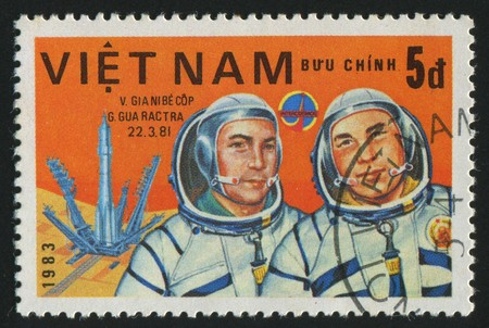VIET NAM - CIRCA 1983: stamp printed by Viet Nam,  shows astronauts Dzhanibekov, Gurragcha, circa 1983 photo