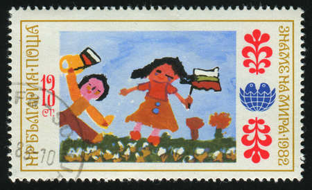 BULGARIA - CIRCA 1982: Childrens drawings. A cute cartoon couple, circa 1982. photo