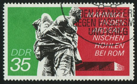 GERMANY - CIRCA 1974: stamp printed by Germany, shows Bound Guerrillas, Ardeatine Caves Rome, circa 1974. photo
