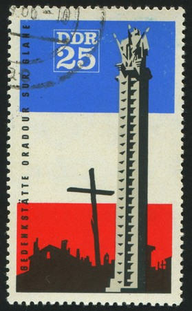 GERMANY - CIRCA 1966: stamp printed by Germany, shows Oradour sur Glane Memorial and French Flag, circa 1966. photo