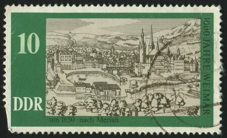 GERMANY - CIRCA 1975: stamp printed by Germany, shows Weimar, 1630, after Merian, circa 1975. photo