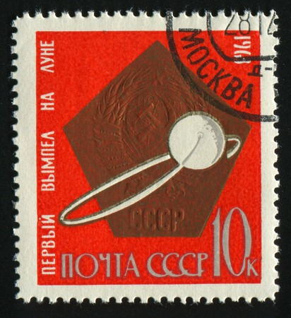 RUSSIA - CIRCA 1963: stamp printed by Russia, shows Rockets and arms, circa 1963. photo