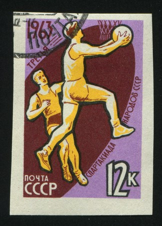 RUSSIA - CIRCA 1963: stamp printed by Russia, shows basketball players and ball, circa 1963. photo