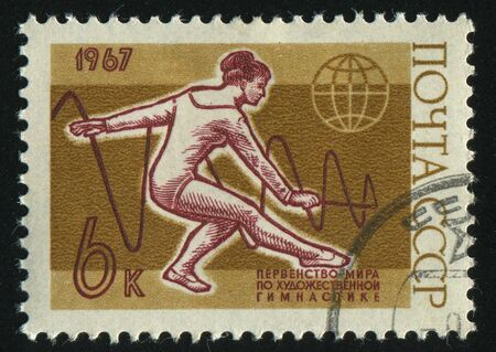 RUSSIA - CIRCA 1967: stamp printed by Russia, shows woman gymnast, circa 1967. photo