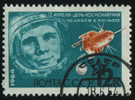 RUSSIA - CIRCA 1964: stamp printed by Russia, shows Gagarin and satellite, circa 1964.