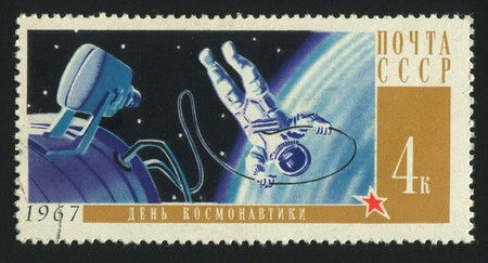 RUSSIA - CIRCA 1967: stamp printed by Russia, shows planet and astronaut,  circa 1967. photo