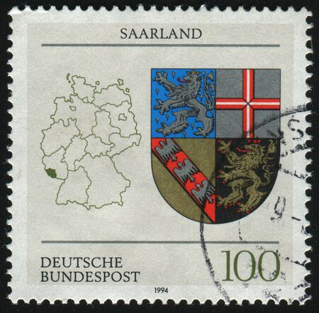 saar: GERMANY- CIRCA 1994: stamp printed by Germany, shows Coats of Arms of states of the Federal republic of Germany, Saar, circa 1994.