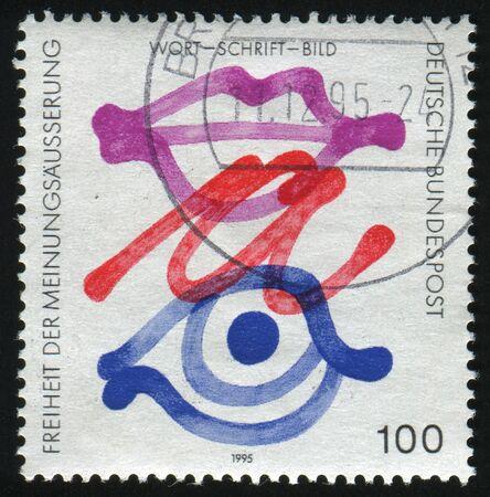freedom of expression: GERMANY- CIRCA 1995: stamp printed by Germany, shows eye, and lips, Freedom of Expression, circa 1995. Stock Photo