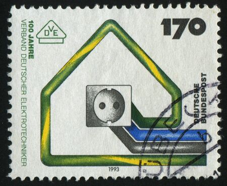 jackplug: GERMANY- CIRCA 1993: stamp printed by Germany, shows emblem Association of German Electrical Engineers, circa 1993. Stock Photo
