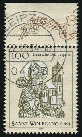 cassock: GERMANY- CIRCA 1994: stamp printed by Germany, shows St. Wolfgang, Bishop of Regensburg, circa 1994. Stock Photo