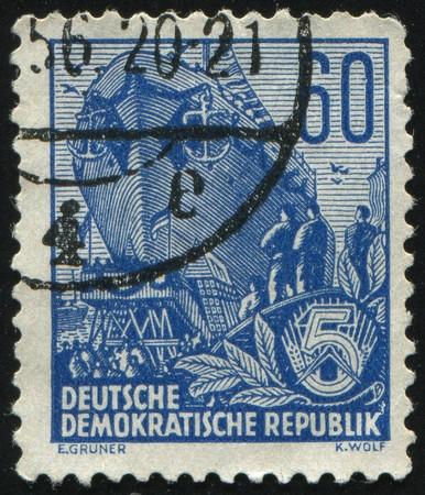 GERMANY- CIRCA 1953: stamp printed by Germany, shows Building the multi-purpose dry cargo sea-river going vessels, circa 1953. photo