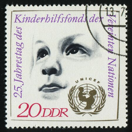 unicef: GERMANY- CIRCA 1971: stamp printed by Germany, shows Childs Head, UNICEF Emblem, circa 1971.