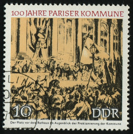 proclamation: GERMANY- CIRCA 1971: stamp printed by Germany, shows Proclamation of the Commune, Town Hall, Paris, circa 1971.