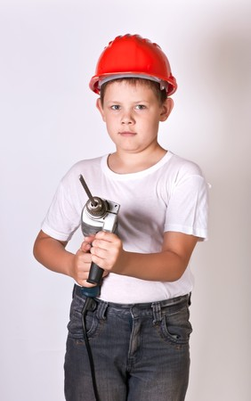Portrait of a boy in a red protective helmet photo