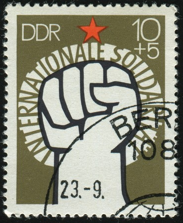 GERMANY - CIRCA 1973: stamp printed by Germany, shows Raised Fist and star, circa 1973 photo