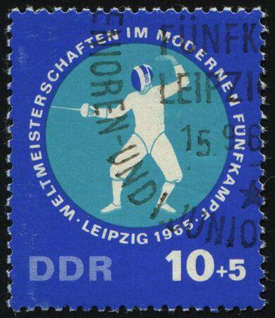 pentathlon: GERMANY- CIRCA 1965: stamp printed by Germany, shows Modern Pentathlon Championships, circa 1965.