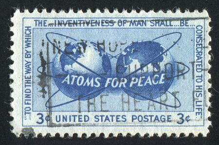 encircling: UNITED STATES - CIRCA 1955: stamp printed by United states, shows Atomic Energy Encircling the Hemispheres, circa 1955