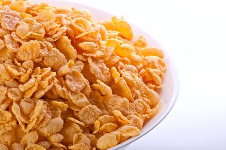 goldish: Goldish corn flakes. Macro with extremely shallow dof. Close-up of cornflakes.