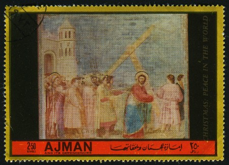 AJMAN - CIRCA 1985: Jesus Christ bears a cross, circa 1985. photo