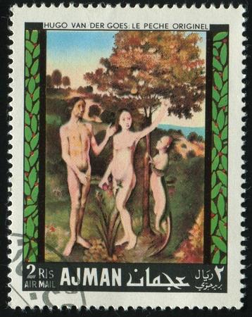 AJMAN - CIRCA 1972: Eve and Adam in gardens Eden, circa 1972. photo