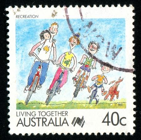 AUSTRALIA - CIRCA 1988: stamp printed by Australia, shows Cartoons, family rides a bicycle, circa 1988