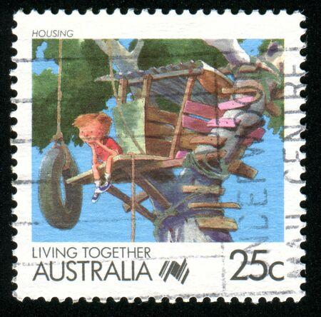 AUSTRALIA - CIRCA 1988: stamp printed by Australia, shows Cartoons, boy in a tree, circa 1988