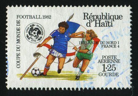 HAITI - CIRCA 1982: stamp printed by Haiti,  shows soccer players and ball, circa 1982. photo