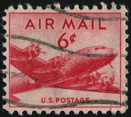 UNITED STATES - CIRCA 1946: stamp printed by United states, shows airplane DC-4, circa 1946. photo