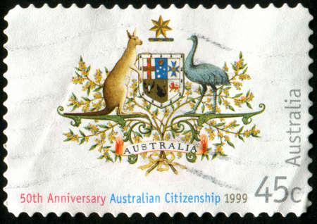 AUSTRALIA - CIRCA 1999: stamp printed by Australia, shows Nationality and Citizenship emblem, circa 1999 photo