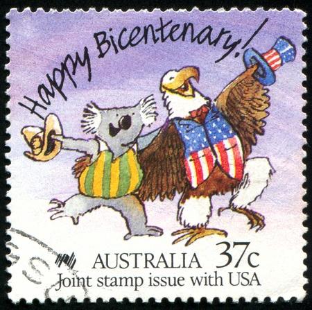 AUSTRALIA - CIRCA 1988: stamp printed by Australia, shows Caricature of Australian Koala and American Bald Eagle, circa 1988 photo