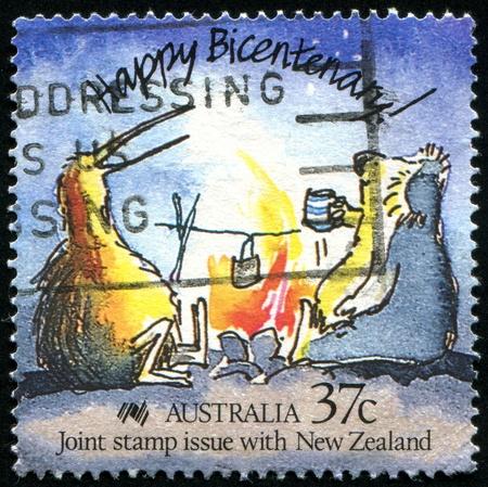 AUSTRALIA - CIRCA 1988: stamp printed by Australia, shows Caricature of an Australian koala and New Zealand kiwi, circa 1988 photo