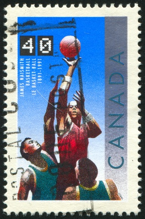 canada stamp: CANADA - CIRCA 1991: stamp printed by Canada, shows  basketball, circa 1991 Stock Photo