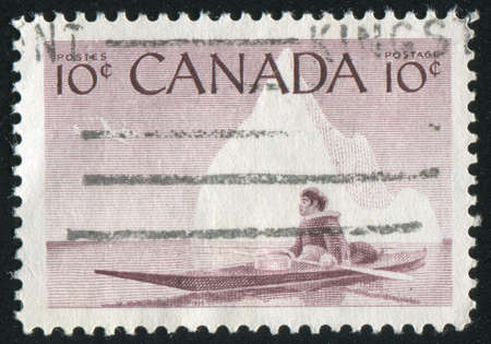 CANADA - CIRCA 1955: stamp printed by Canada, shows Eskimo and Kayak, circa 1955 Stock Photo - 8608443