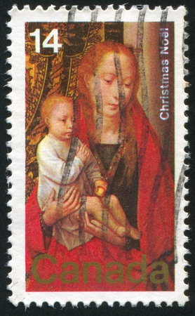 CANADA - CIRCA 1978: stamp printed by Canada, shows Virgin and Child, circa 1978 Stock Photo - 8608485