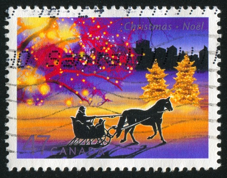 horse sleigh: CANADA - CIRCA 2001: stamp printed by Canada, shows Illuminated trees, circa 2001 Stock Photo