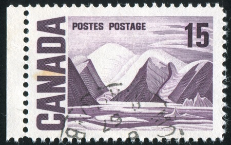 CANADA - CIRCA 1967: stamp printed by Canada, shows �Bylot Island� by Lawren Harris, circa 1967 Stock Photo - 8661771