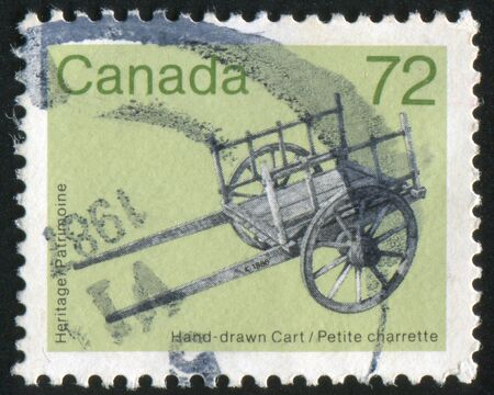 artifacts: CANADA - CIRCA 1986: stamp printed by Canada, shows Heritage Artifacts, cart, circa 1986 Stock Photo