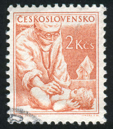 CZECHOSLOVAKIA - CIRCA 1954: stamp printed by Czechoslovakia, shows Physician and baby, circa 1954 photo