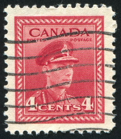 CANADA - CIRCA 1943: stamp printed by Canada, shows King George VI in Army Uniform, circa 1943 Stock Photo - 8715374