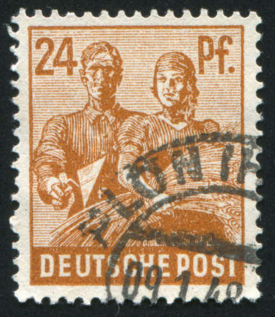 reaping: GERMANY - CIRCA 1946: stamp printed by Germany, shows Reaping Wheat, circa 1946