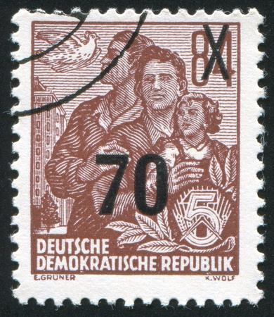 GERMANY - CIRCA 1953: stamp printed by Germany, shows Dove and East German family, circa 1953 Stock Photo - 8824163
