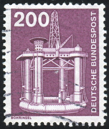GERMANY - CIRCA 1975: stamp printed by Germany, shows Oil drilling, circa 1975 photo