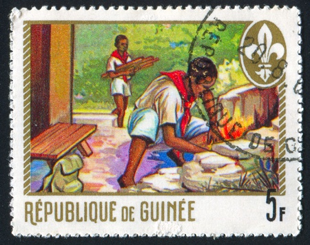 pioneers: GUINEA - CIRCA 1974: stamp printed by Guinea, shows pioneers, circa 1974 Stock Photo