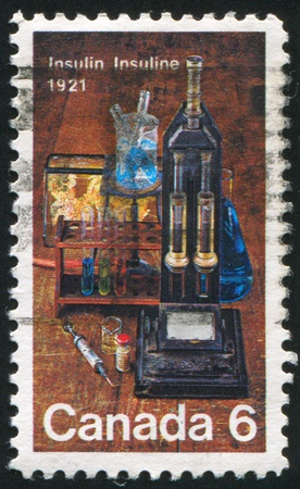 CANADA - CIRCA 1971: stamp printed by Canada, shows Laboratory Equipment Used for Insulin Discovery, circa 1971 photo