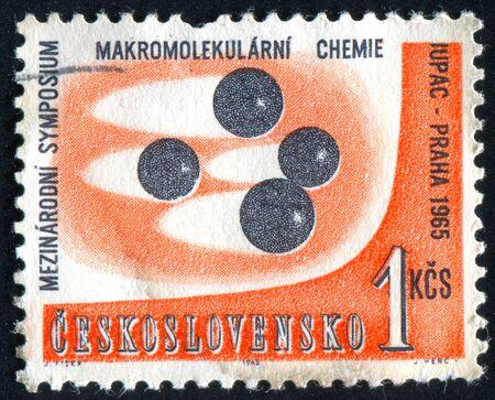 CZECHOSLOVAKIA - CIRCA 1965: stamp printed by Czechoslovakia, shows Macromolecular Symposium Emblem, circa 1965 Stock Photo - 8987948