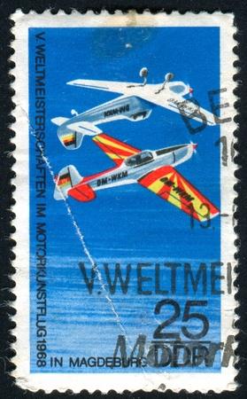 GERMANY - CIRCA 1968: stamp printed by Germany, shows �Trener� Stunt Plane, circa 1968 photo