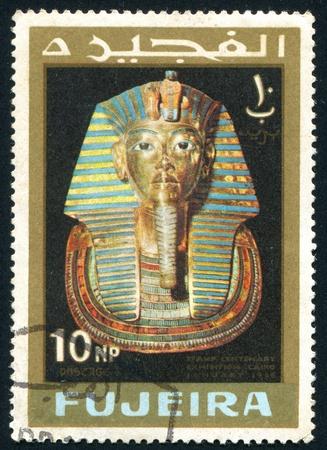 FUJEIRA - CIRCA 1966: stamp printed by Fujeira, shows golden mask of egyptian pharaoh, circa 1966 Stock Photo